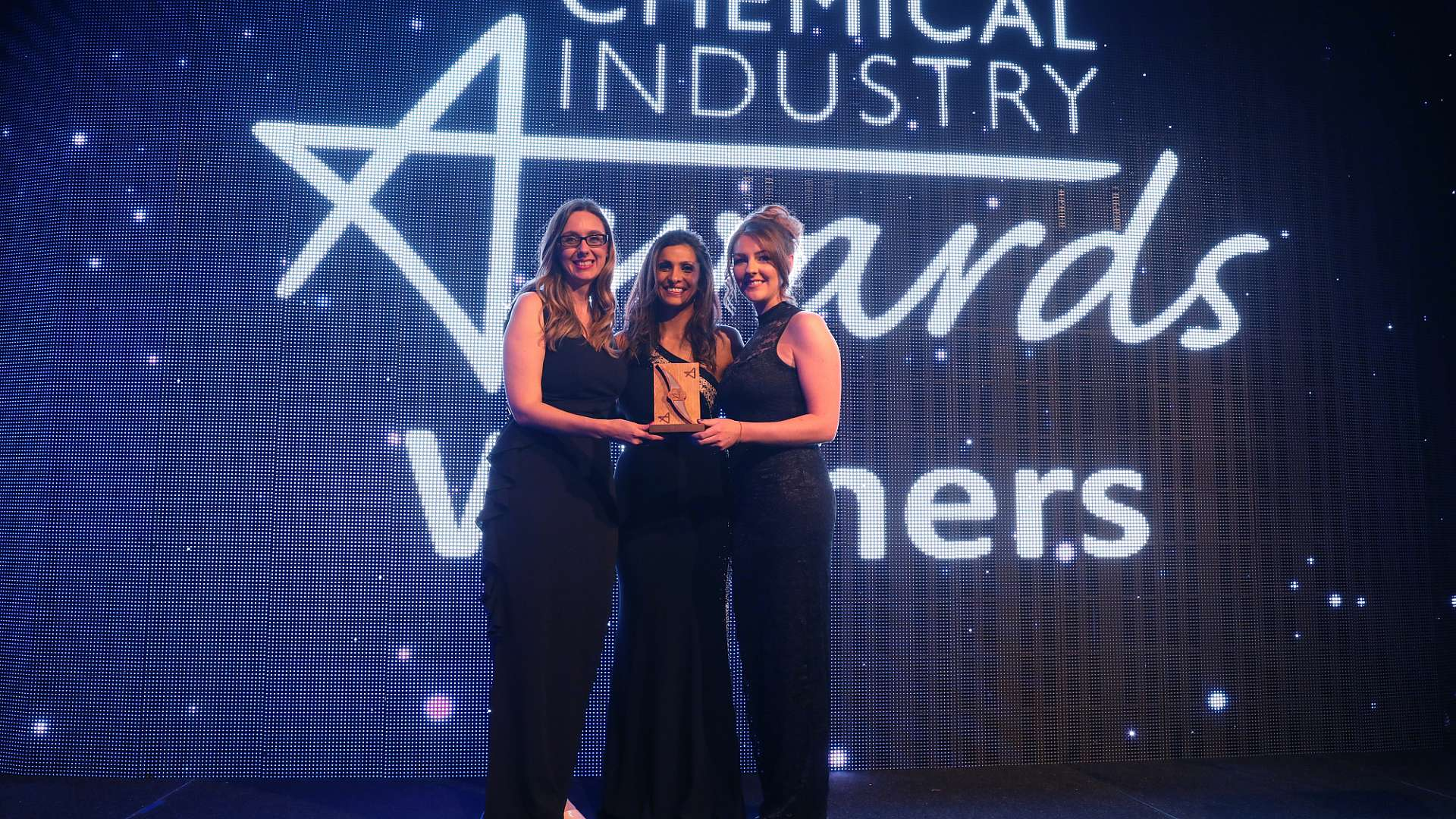 Louise Barker, CPI's Head of Performance & Impact, left, with Sarah Scarr, CPI Impact Analyst, right, and awards host Sameena Ali-Khan
