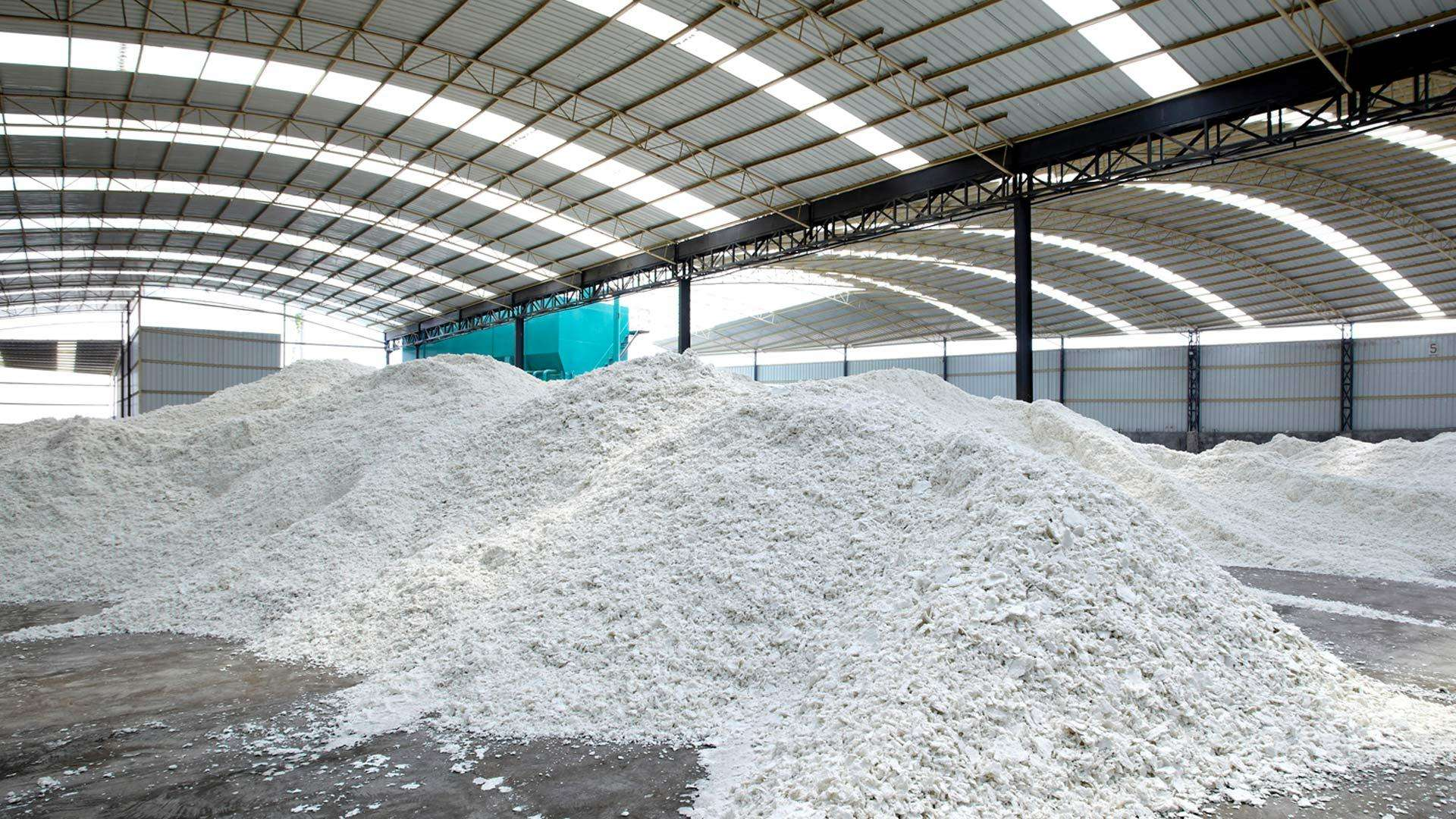 A photo of large mounds of pulp in a warehouse