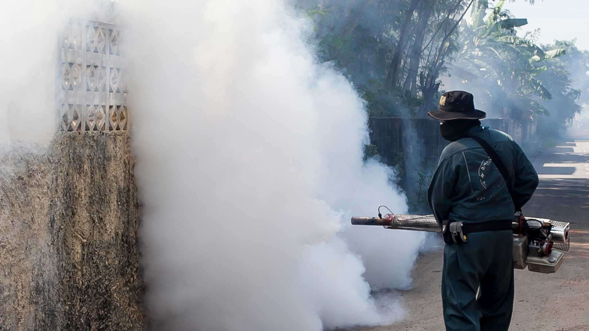 A man fogs mosquitoes to prevent the spread of the Zika virus