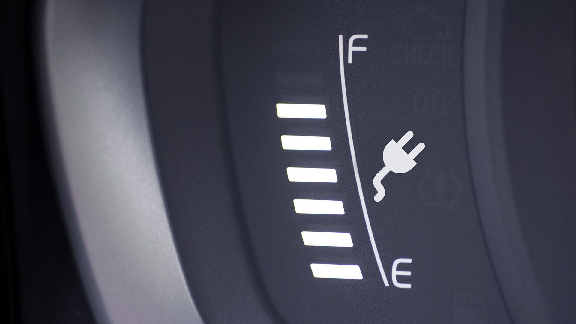 A photo of an energy level indicator on a car dashboard