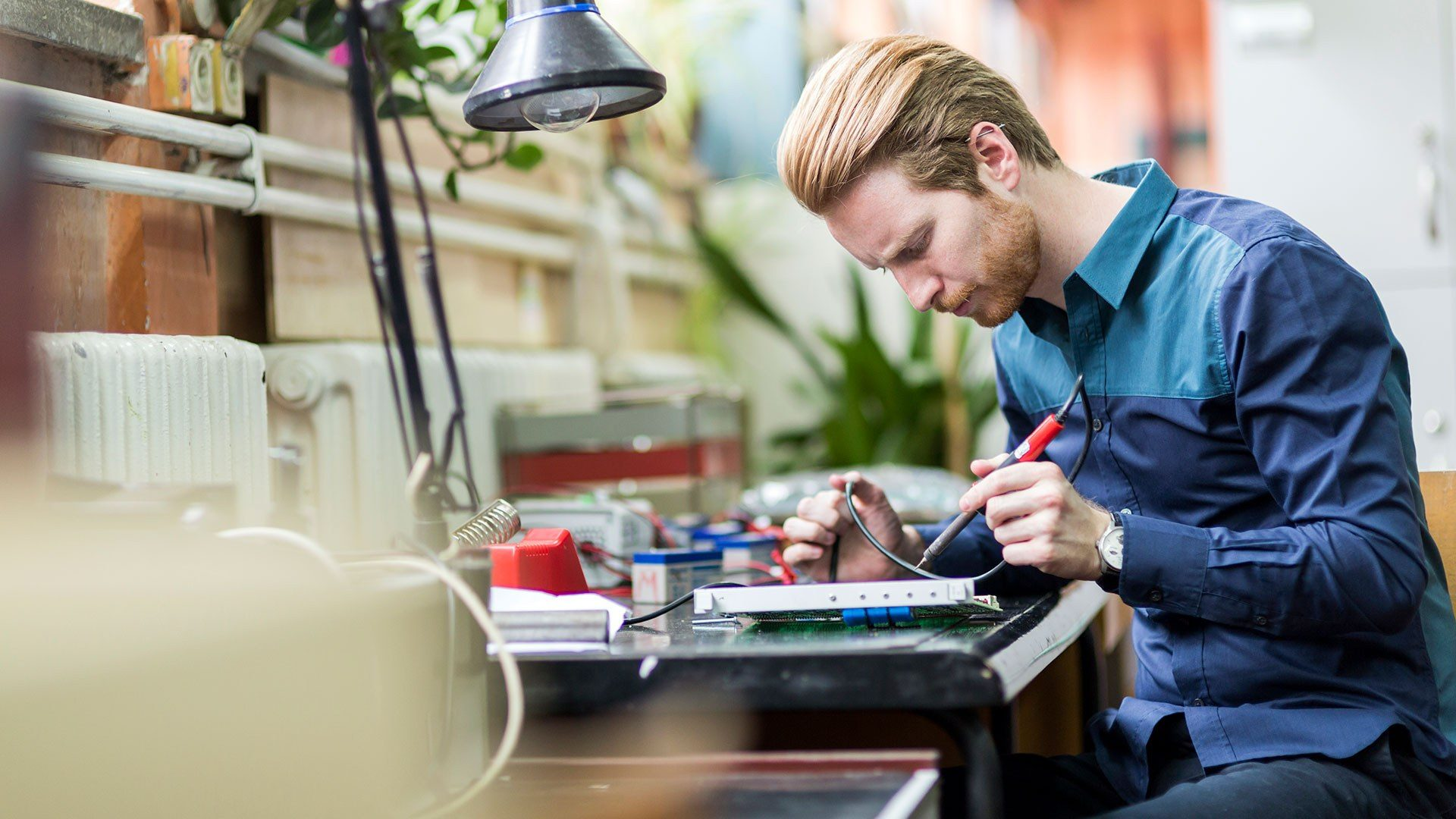 A photo of an engineer running diagnostic tests on a battery