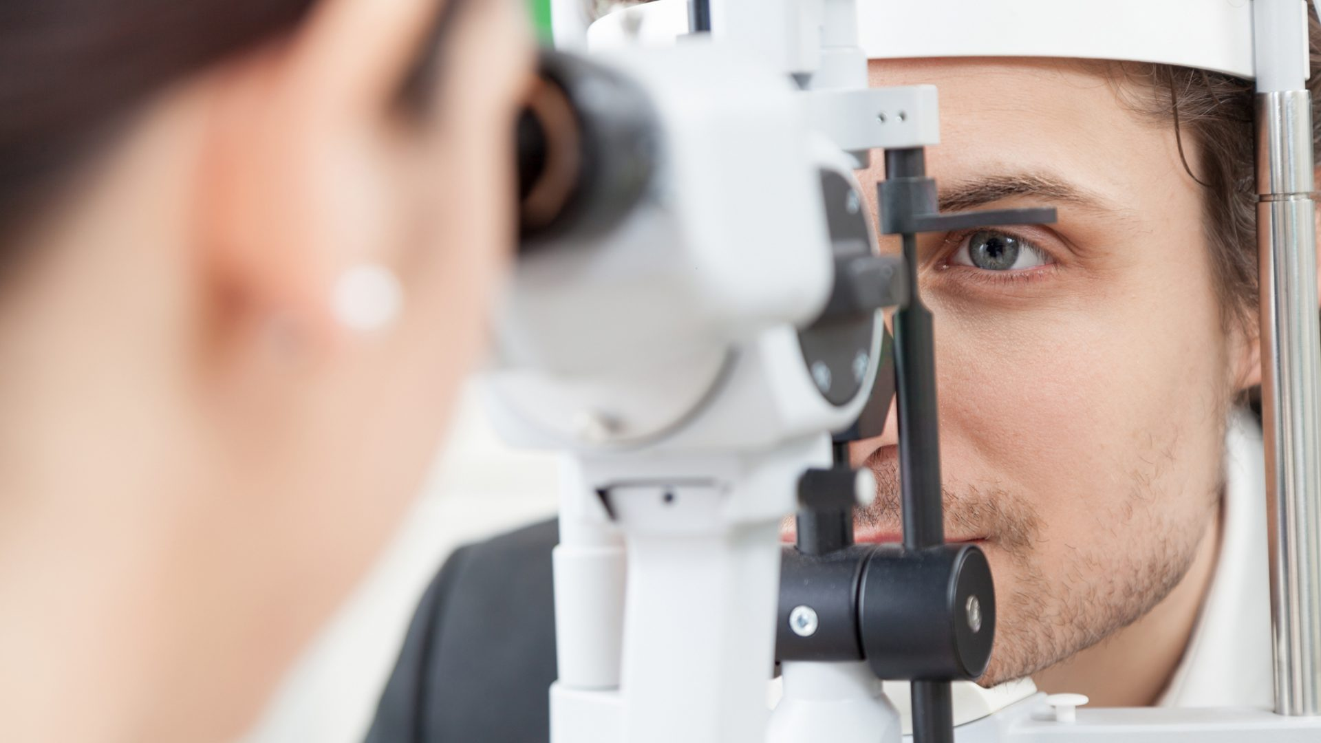 A photo of a person having an eye test