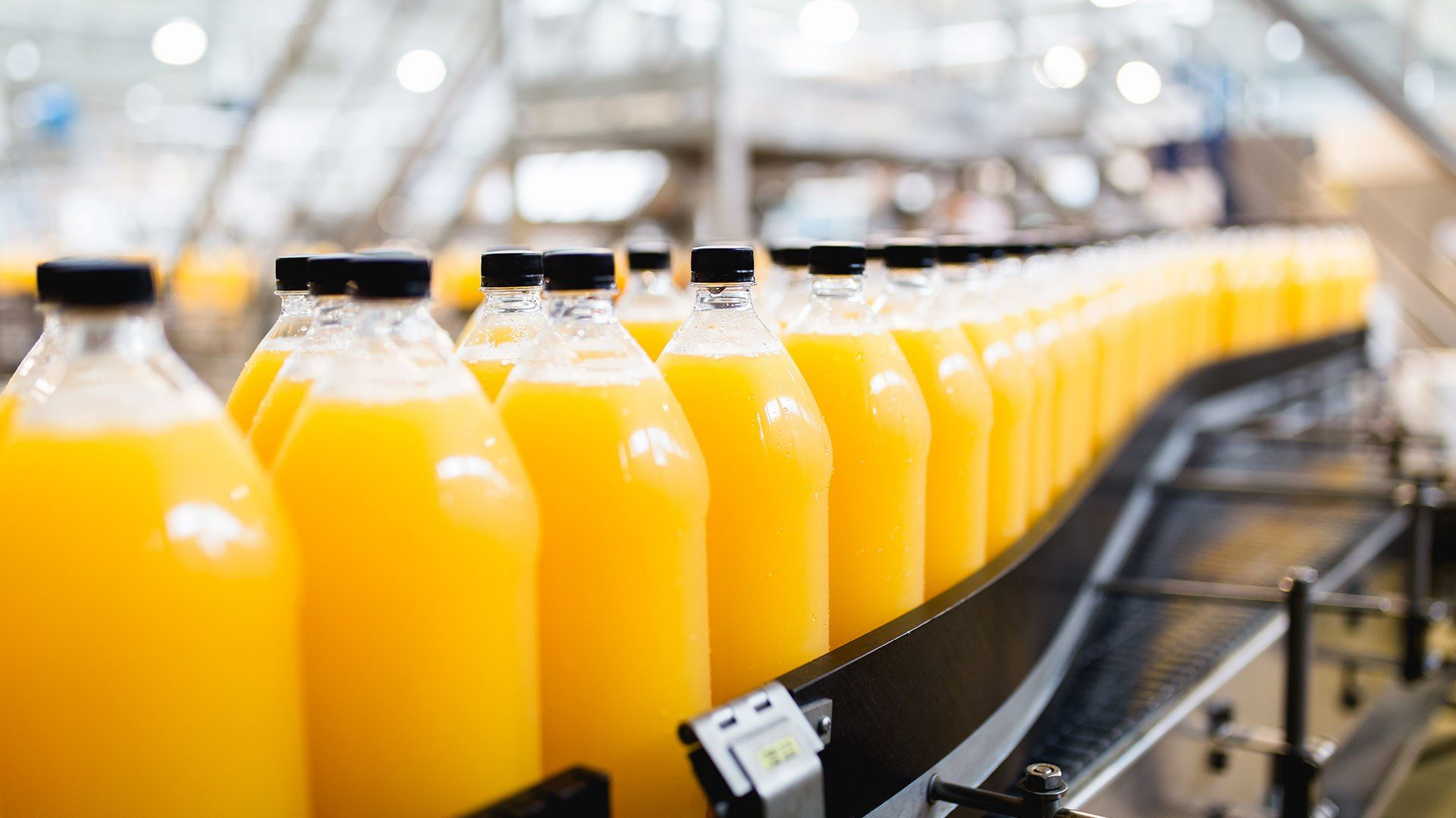 A photo of fruit juice being bottled