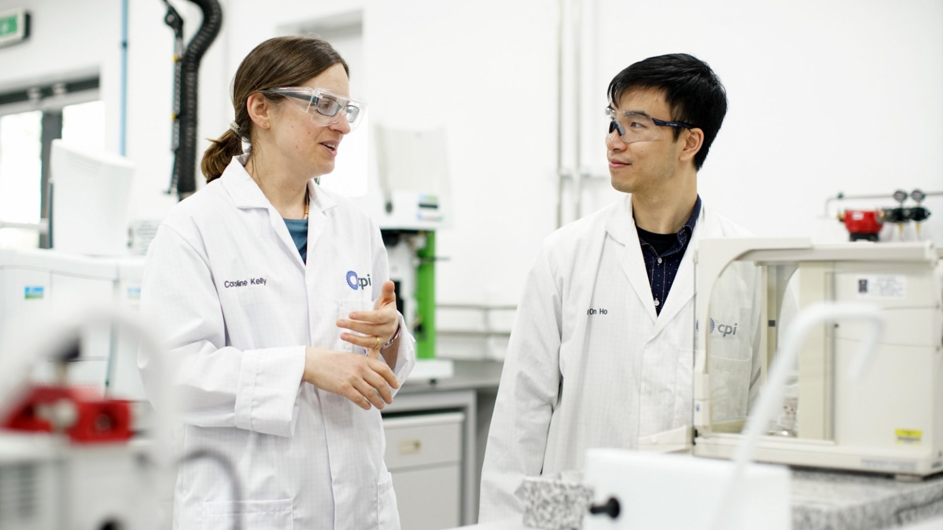 A photo of two CPI staff members having a discussion in a laboratory