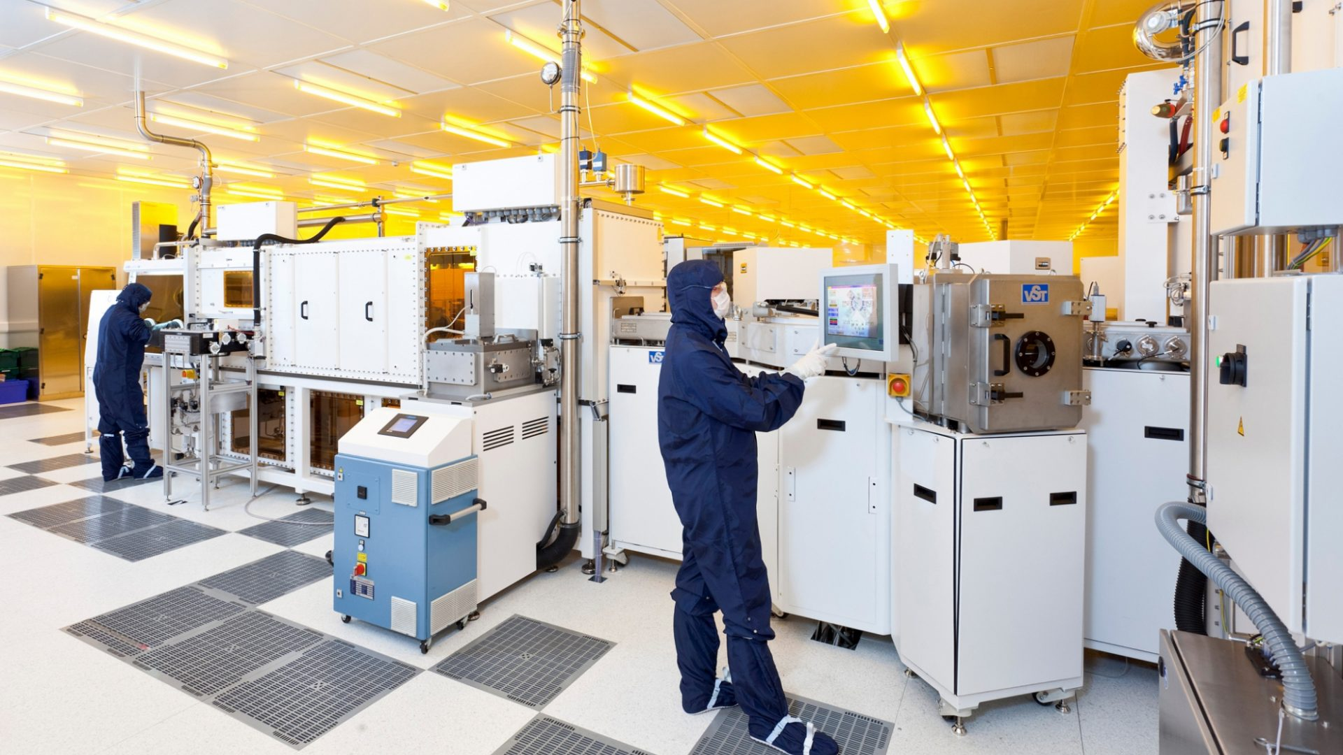 A photo of CPI scientists using cutting-edge electrical equipment in a cleanroom
