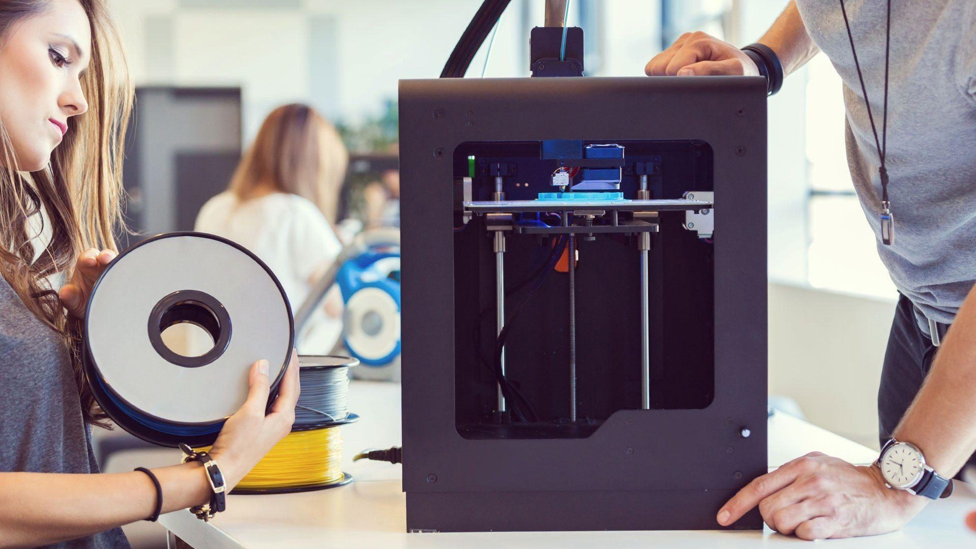 Photo of a 3D printer being configured
