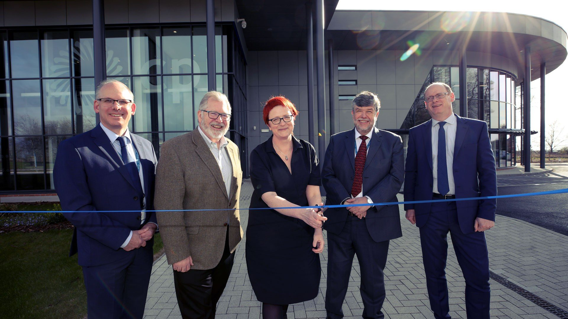 Ribbon cutting outside the new centre: l-r Tom Harvey, Healthcare Photonics Lead at CPI; Paul Goodwin, GE Healthcare Science Director and external advisory board member; Anke Lohmann, Chair of the External Advisory Board; Nigel Perry CEO of CPI, Alan Welby, Innovation Director at North East Local Enterprise Partnership.