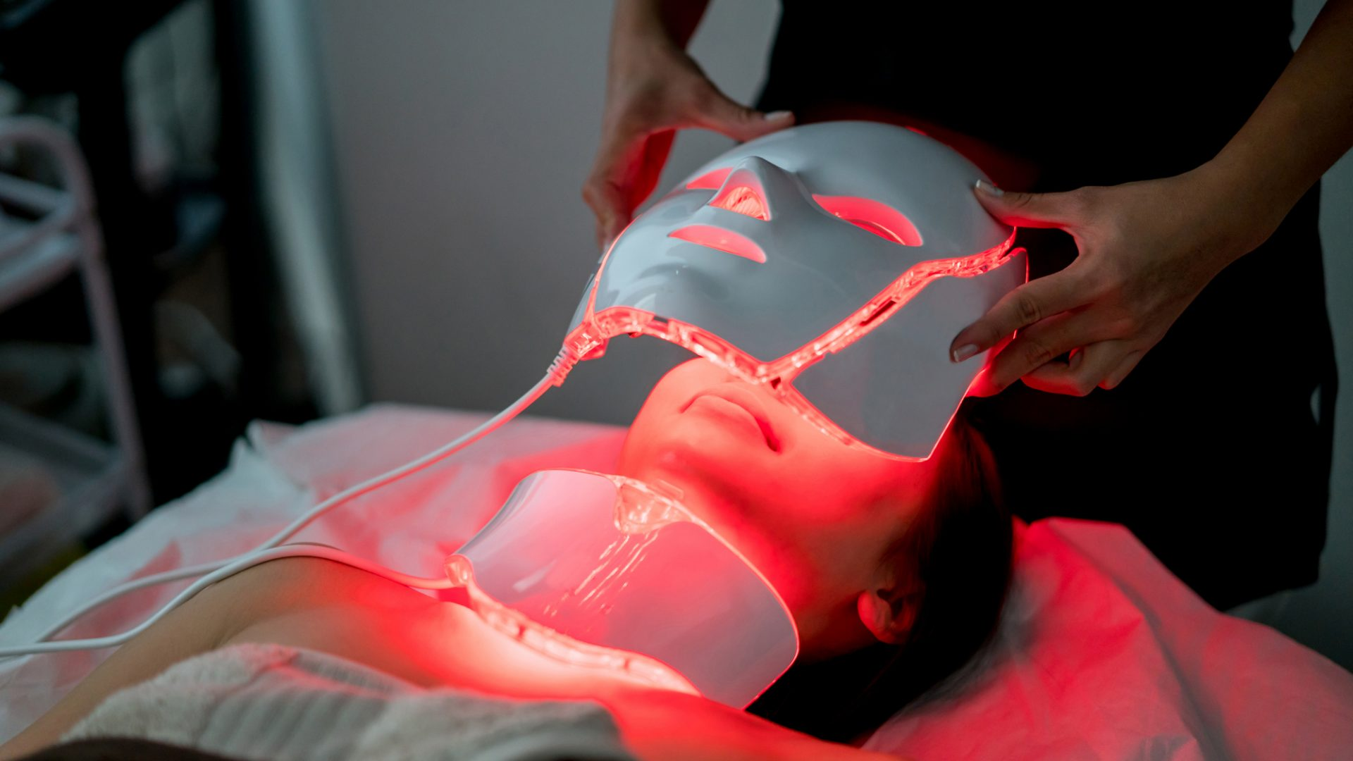 A photo of a person undergoing a photonics skin treatment