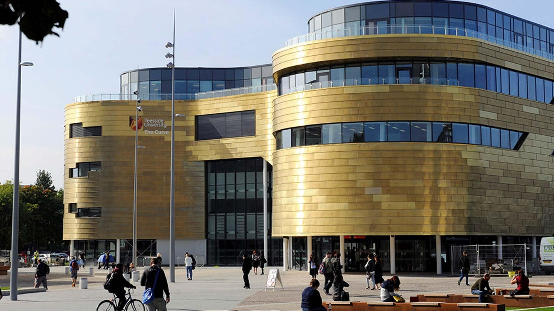 A photo of a Teesside University with students outside